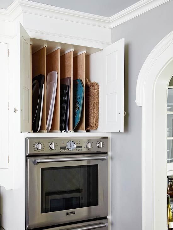 I did something similar at my old house in 1/2 of over-range cabinet -  great for storing cookie sheets, cooking racks, and baking stones, perfect use of a large space you can't get to the back of, and convenient to oven