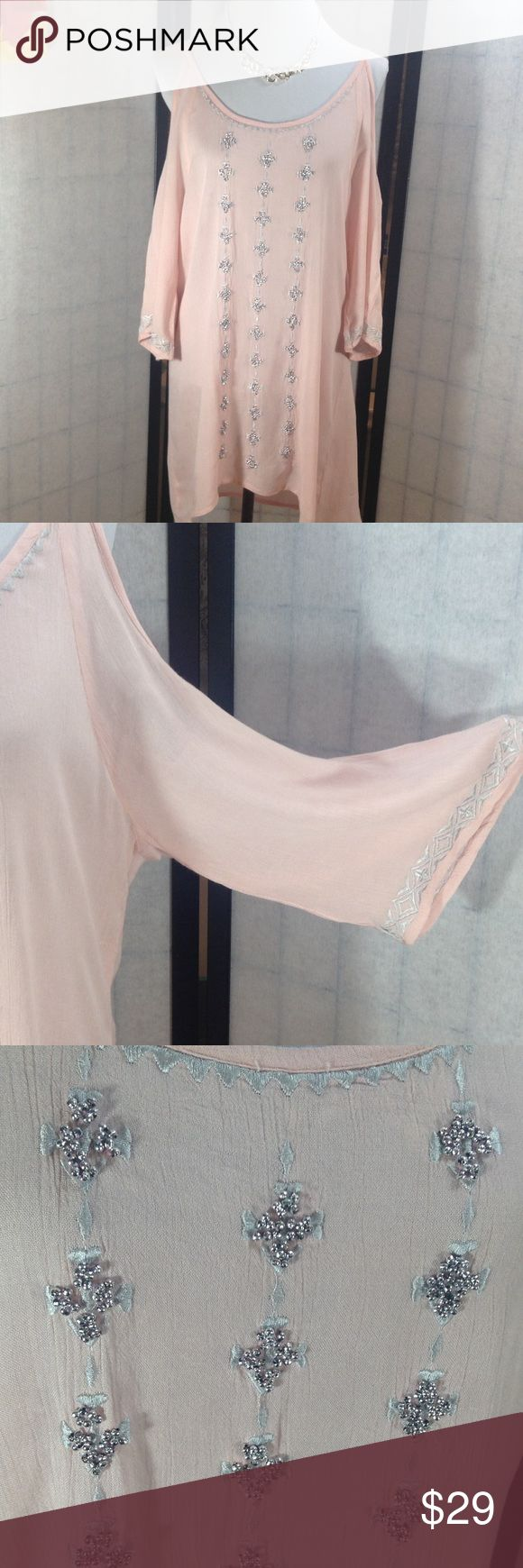 """Romeo & Juliet Couture Beach dress Color is called Blush - a pale pink - with silver beading and embroidery; so sweet and pretty; cold shoulder; 3/4 sleeves with a wide cuff; fabric is somewhat sheer - would probably need to wear something under unless very brave!; size M but runs larger; measured flat app pits 20""""; shoulder to hem 33""""; NWT (T-25) Romeo & Juliet Couture Dresses"""