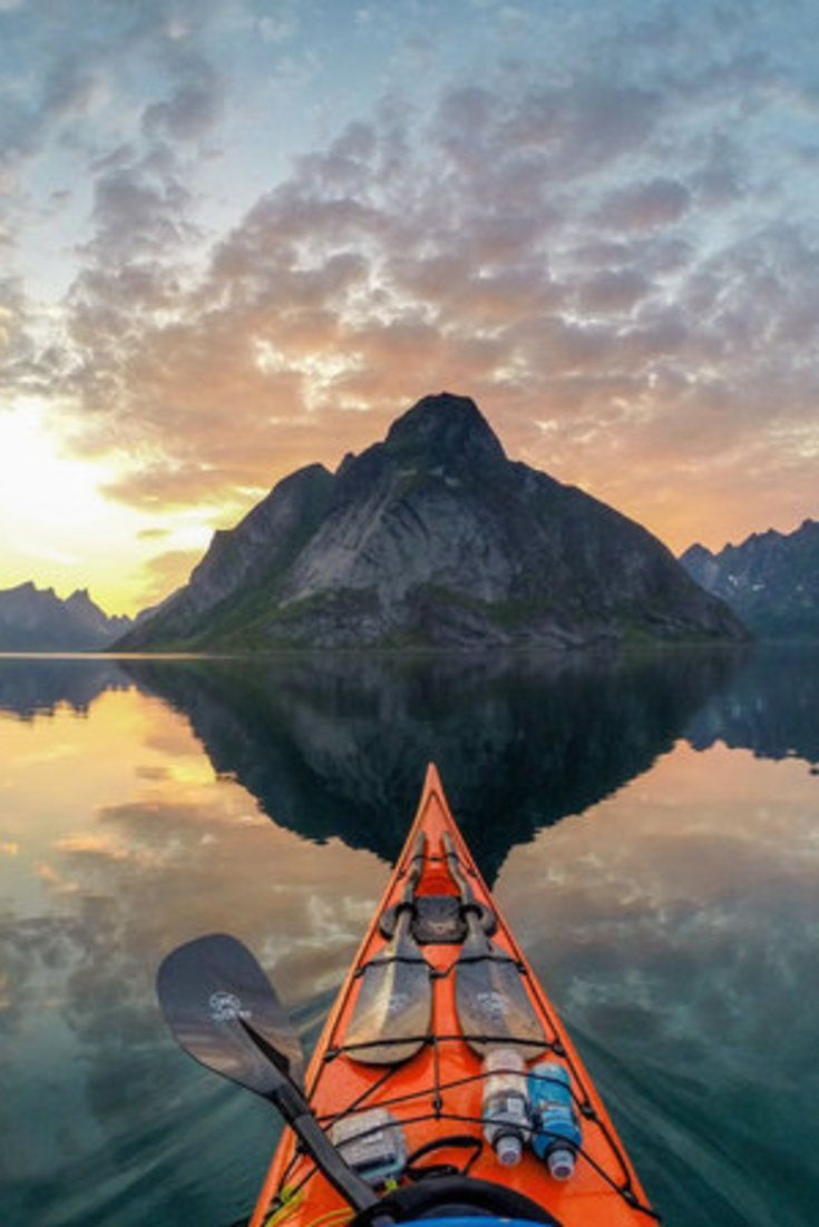 The Epic Photo Series That'll Convince You To Travel Solo | Never underestimate the glory of traveling solo, because you'll learn things you can't learn any other way. Tomasz Furmanek can attest to this firsthand: he spent about 3 years documenting Norway's picture-perfect fjords from the seat of his sea kayak, often completely alone.