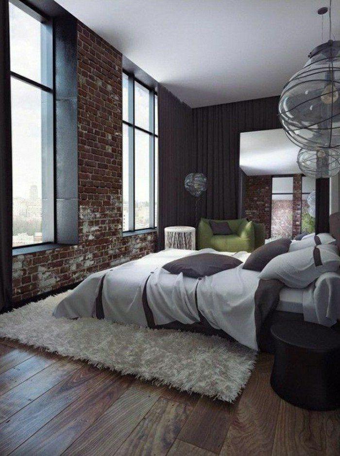 jolie chambre coucher avec parement mural en briques rouges