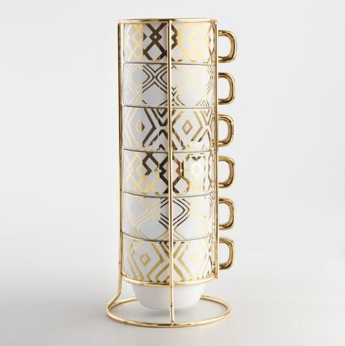 Perfect for coffee or tea with a space-saving design, these stacking mugs feature metallic geometric patterns
