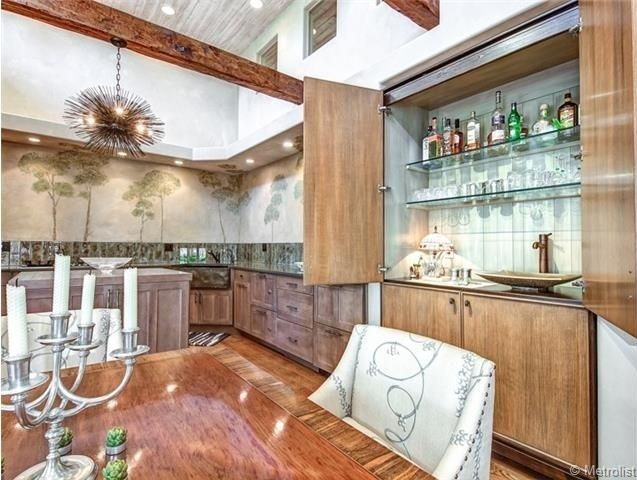 Eclectic Bar with Wet bar, Built-in bookshelf, Exposed beam, High ceiling, Hardwood floors, Vessel sink