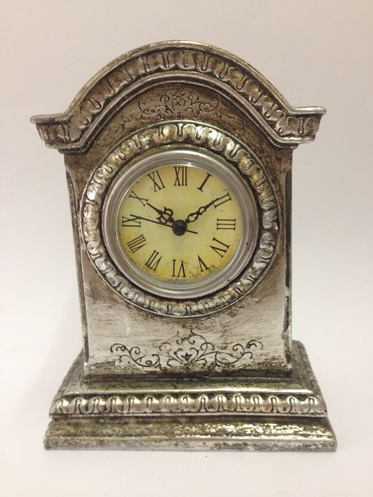 Silver Effect Mantle Clock £14.99: Ornate silver effect mantle clock that has a distressed finish giving it an antique look. Features roman numerals on clock face, takes one AAA battery (not provided). Approx Dimensions: H: 17.5cm x W: 13.5cm x D: 7cm