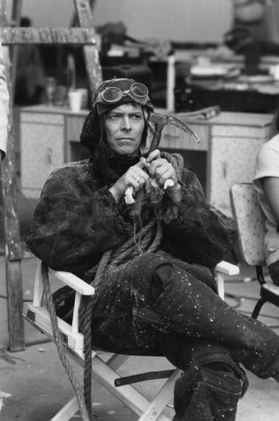 Why is David Bowie holding an old school ice hammer and dressed like a mountaineer from the 30's?
