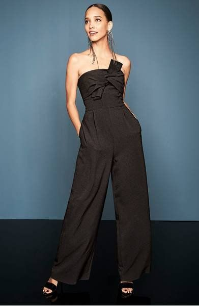 A knotted strapless bodice perfectly balances the flowing trousers of this crepe jumpsuit that's both versatile and flattering.