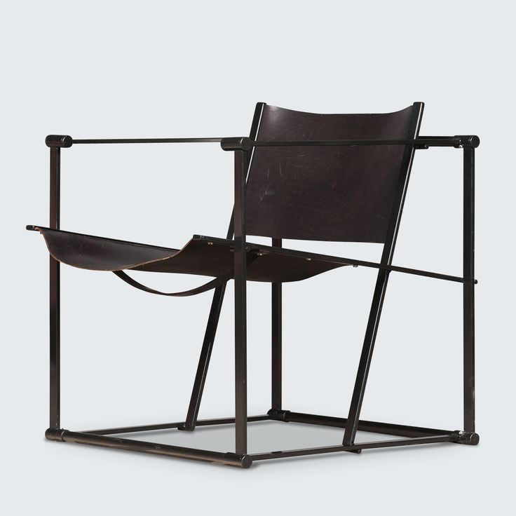 Striking and sculptural! What an amazing statement chair that is a perfect expression of modern Dutch design aesthetics. Inspired by the Dutch artistic movement De Stijl (think Mondrian and Gerrit Rietvelds Red and Blue Chair) Raboud van Beekum has distilled his FM60 Cubic chair into its essential linear forms –  a cube intersected with the two planes of a chair. The saddle leather used for the seat and back is the perfect material as it follows the linear forms of the chair while providing…