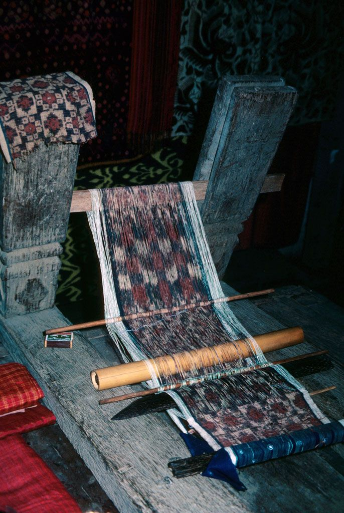 Double ikat weaving of Tenganan village, Bali - Patterns are tied into the warp (vertical) or the weft (horizontal) threads, but not both. The Tenganan designs are tied and dyed into both warp and weft threads before the two types are interwoven for a final pattern, the precision techniques closely guarded secrets by Tenganan families. The textiles are considered to have protective magical powers and are also used to send off the deceased in religious rituals such as cremations