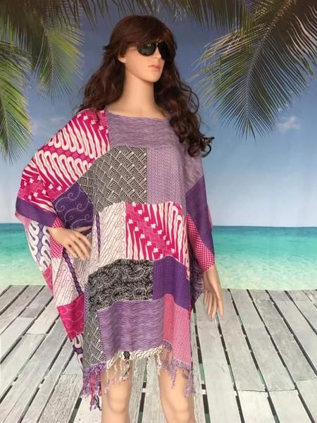A beautiful selection of colours drawn together in stunning patchwork inspired print to create a lovely plus size kaftan top. Just perfect as a beach cover up or with black leggings / pants.