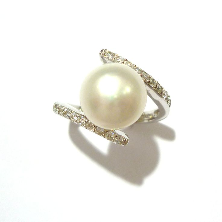 Fresh water pearl set in silver with zirconias studded into the top of the band. This ring also comes in a black fresh water pearl. #pearl #silver #ring