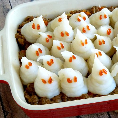 ~Mashed Potato Ghosts~ On top of a Shepard's Pie or to serve on many other Halloween plates.