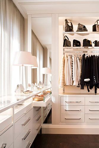 outrageous LONG glass topped accessories cabinet w/pull out drawers & right under the window for light....back lit recessed area on other wall w/drawers beneath... lovely dressing room by POWELL & BONNELL