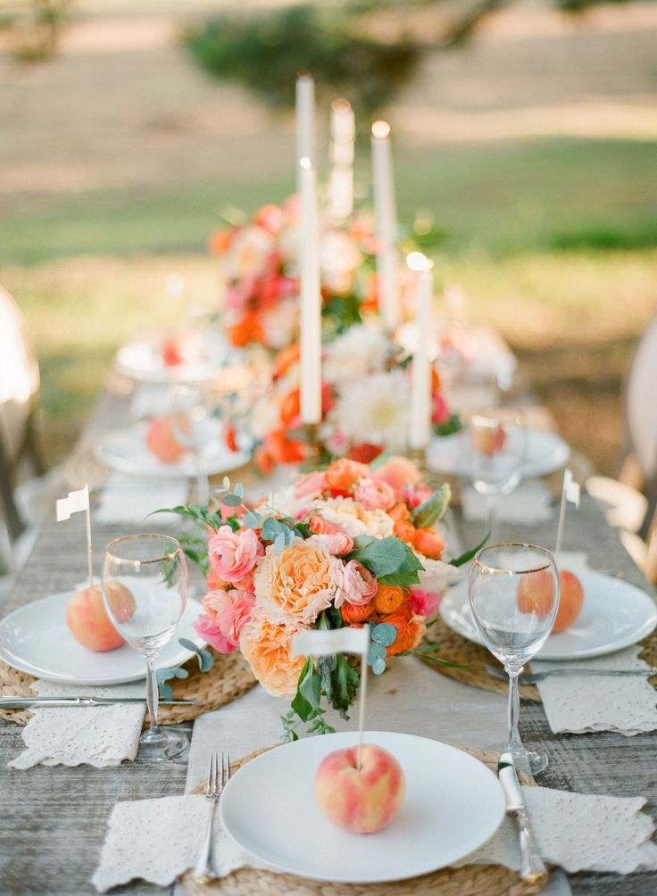 Simple and vibrant peach and coral floral arrangements for the wedding reception…