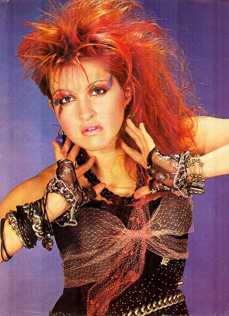 Cyndi Lauper is an 80s icon! Red hair, shaved on one side with bold make up. #80s #makeup