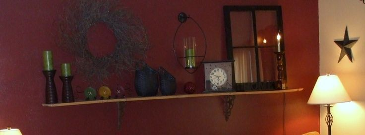 my home made barn board shelf above couch- love ch…