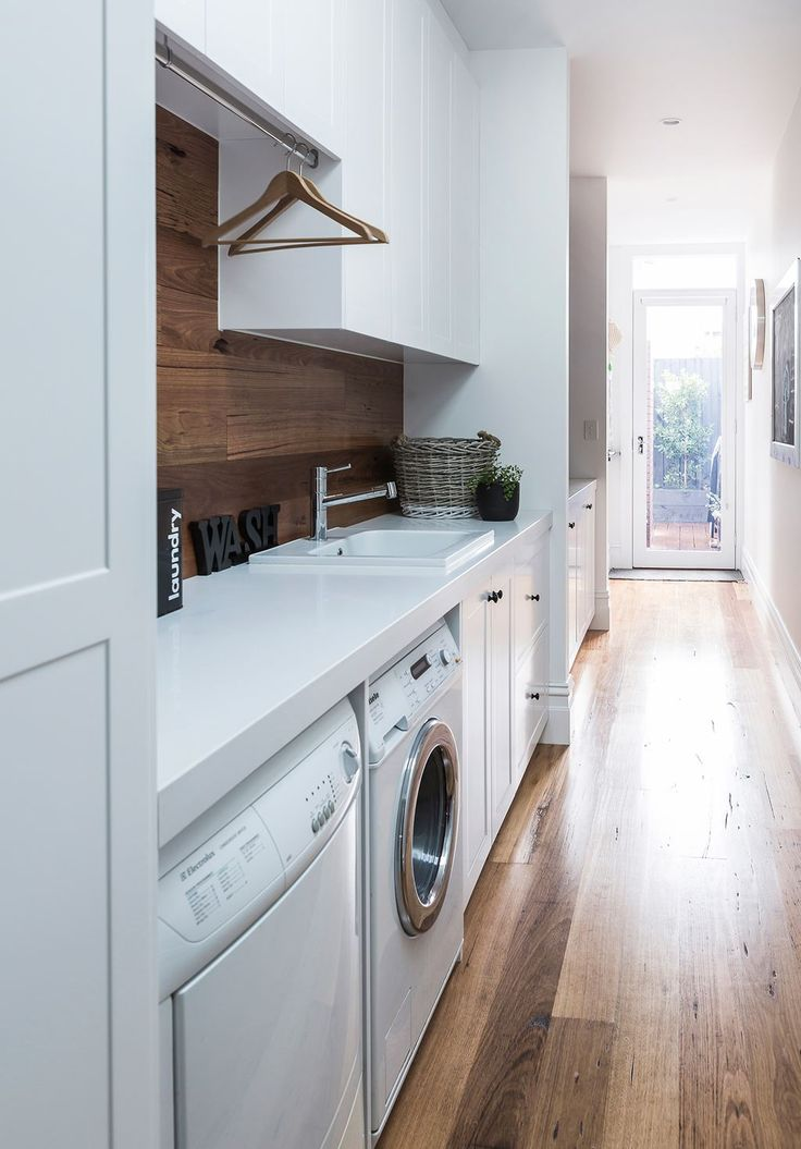 Rachel and Marty's modern-classic Victorian cottage renovation:A narrow hallway leading to the backyard was turned into a practical yet pretty internal laundry.