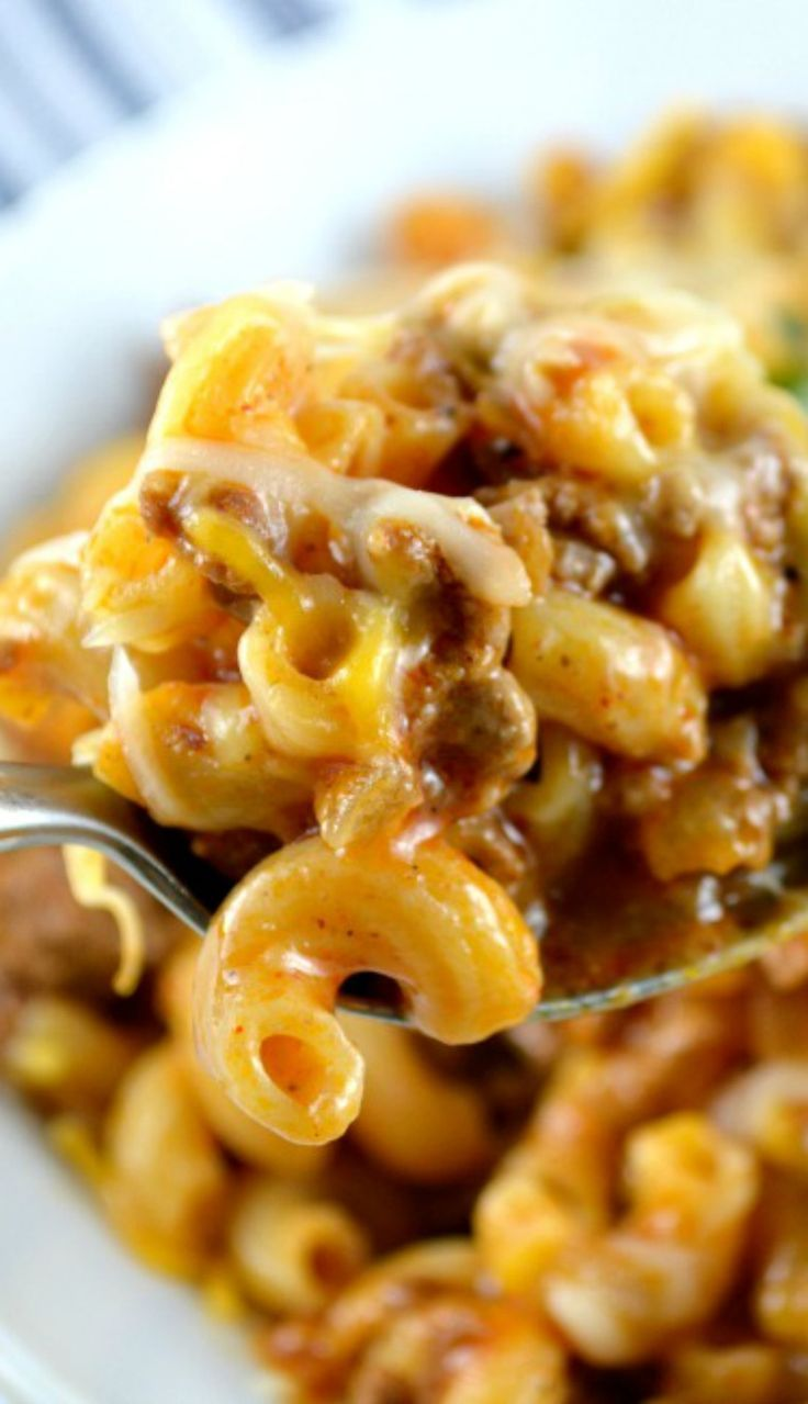 One Skillet Cheesy Chili Mac! Delicious, cheesy and gooey. Perfectly cooked pasta, meaty chili loaded with cheese all made together in ONE PAN!