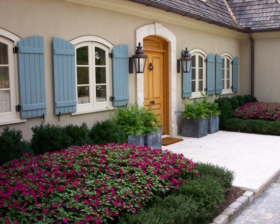 French Country Architecture Cottage Design With Blue Shutters Wrought Iron Lamps And Arched Windows A Decorating Homes Beautiful Places Es