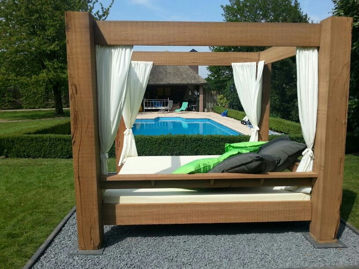 Elegant Single Outdoor Canopy Bed With Wooden Frame And White Curtains Also  White Bed Also Green And Black Pillows