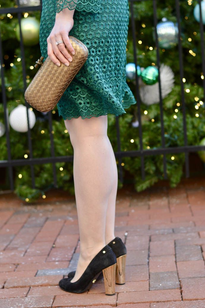 Emerald green lace dress, gold woven clutch and black suede pumps with gold heels.