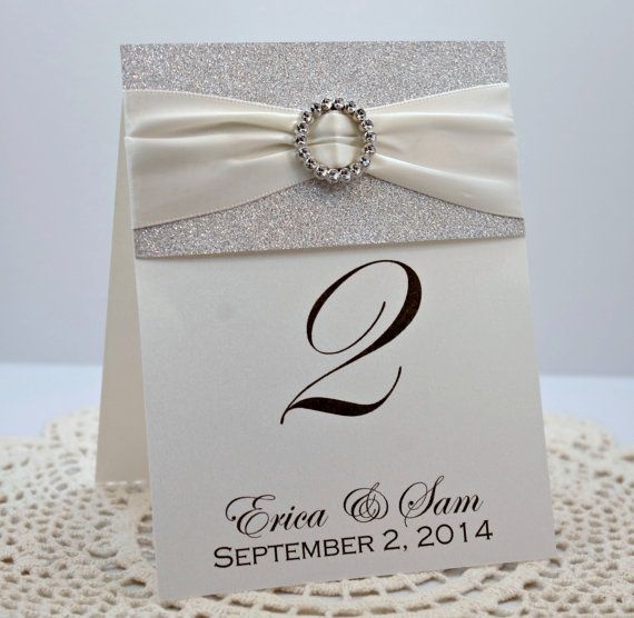 Youve set the tone for your big day with invitations full of bling. The next step is to add touches of sparkle to your reception. These table numbers