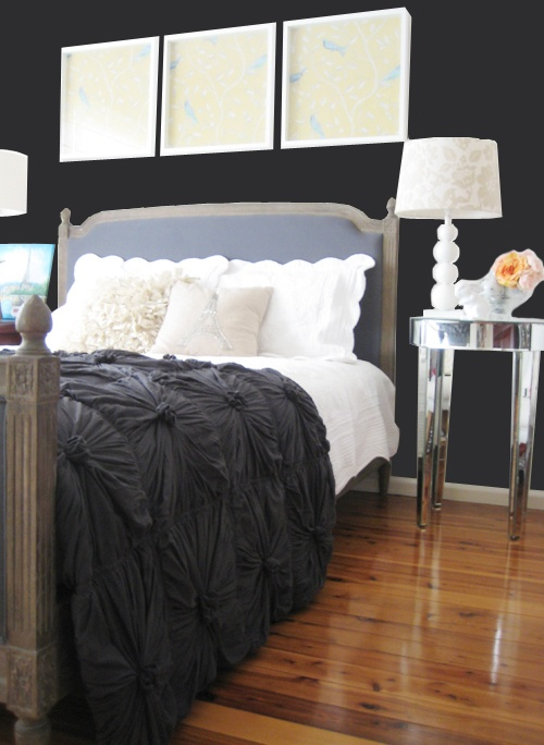black wall and fun bedspread in the bedroom