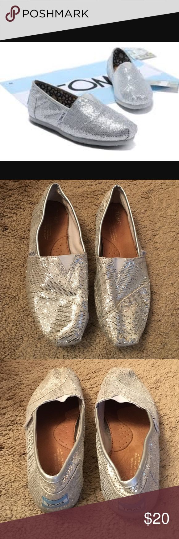 New Listing! Silver glitter TOMS Silver Glitter TOMS slip ons. Gently used with lots of life left. Size - 7.5 TOMS Shoes Flats & Loafers