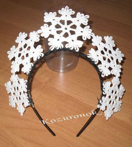 На новогоднем утреннике в саду дочка была Снежинкой. Идею костюма нашла в Интернете. Из вязания крючком в костюме только корона-ободок.  Но, думаю, пара фотографий не по теме не повредит.