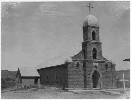 """In 1882, when Nuestra Señora del Refugio Catholic Church was built in the Pecos River Valley, Puerto de Luna was the seat of Guadalupe County and claimed 1,500 residents. Today, only about 200 locals call """"PDL"""" home. Mass is still held at the church. Ray Robinson took this photo in 1958. Palace of the Governors Photo Archives 056333."""