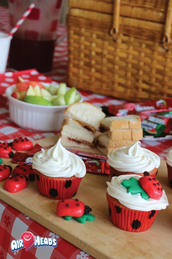 Throw your kids a fun Ladybug Indoor Picnic Party with delicious snacks of fresh fruit and tasty desserts like these Ladybug Cupcakes! Easily mold and craft Airheads candy into fun shapes to decorate your festive sweet treats—perfect for school parties.
