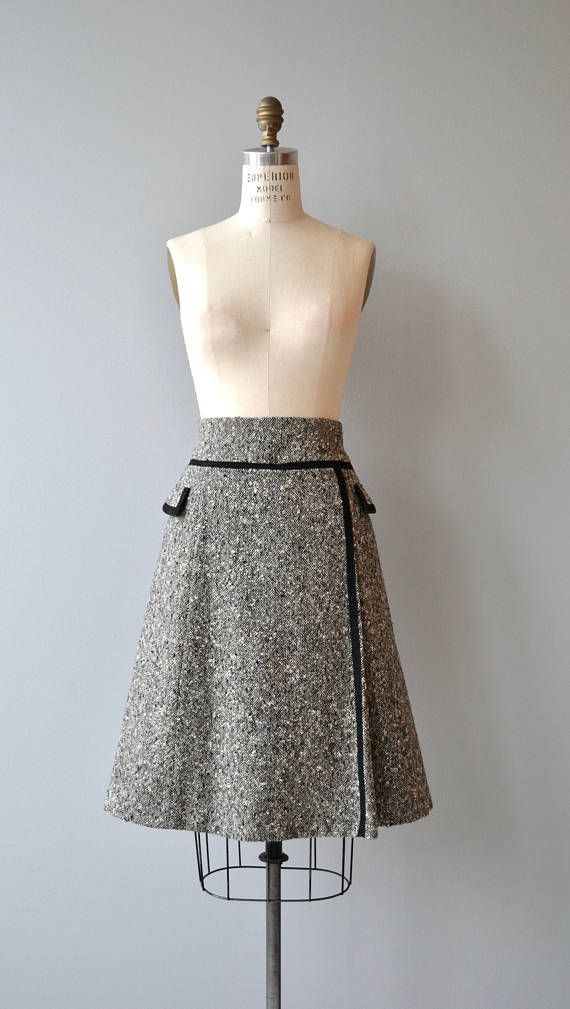 Vintage 1960s Pierre Balmain black and white tweed skirt with mod A-line shape and black trim. Lined.  --- M E A S U R E M E N T S ---  fits like: medium waist: 28 hip: 37 length: 26 brand/maker: Pierre Balmain condition: excellent  To ensure a good fit, please read the sizing guide: