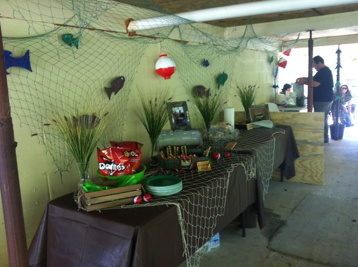 My sons third birthday party, Gone Fishing :) fish net from dollar tree and table clothes, grass floral from hobby lobby.