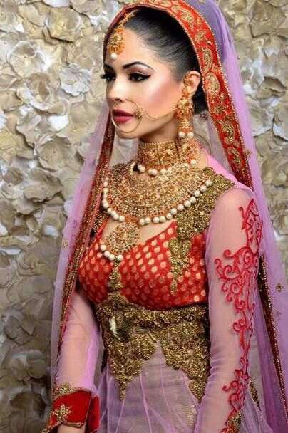 South Asian bride in red and white long sleeve outfit