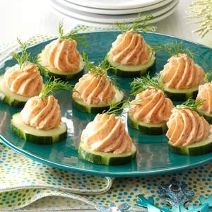 Salmon Mousse Canapes Recipe -It's so easy to top crunchy cucumber slices with a smooth and creamy salmon filling. Guests rave about the fun presentation, contrasting textures and refreshing flavor.
