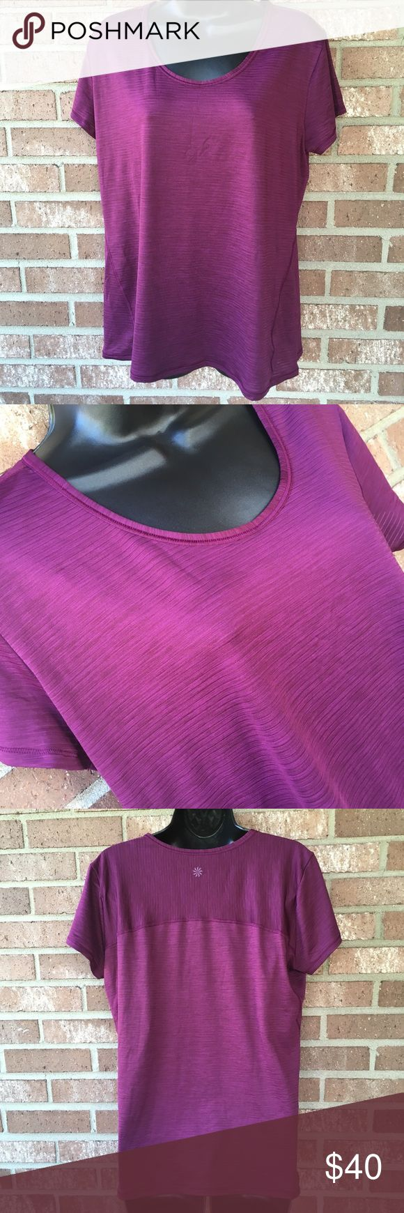 Athleta Purple Short Sleeve Athletic Top Size XL Athleta Athletic Short Sleeve top! Size XL Good used condition overall! Polyester/Spandex blend A cute shade of purple! Perfect colour for the fall! Athleta Tops