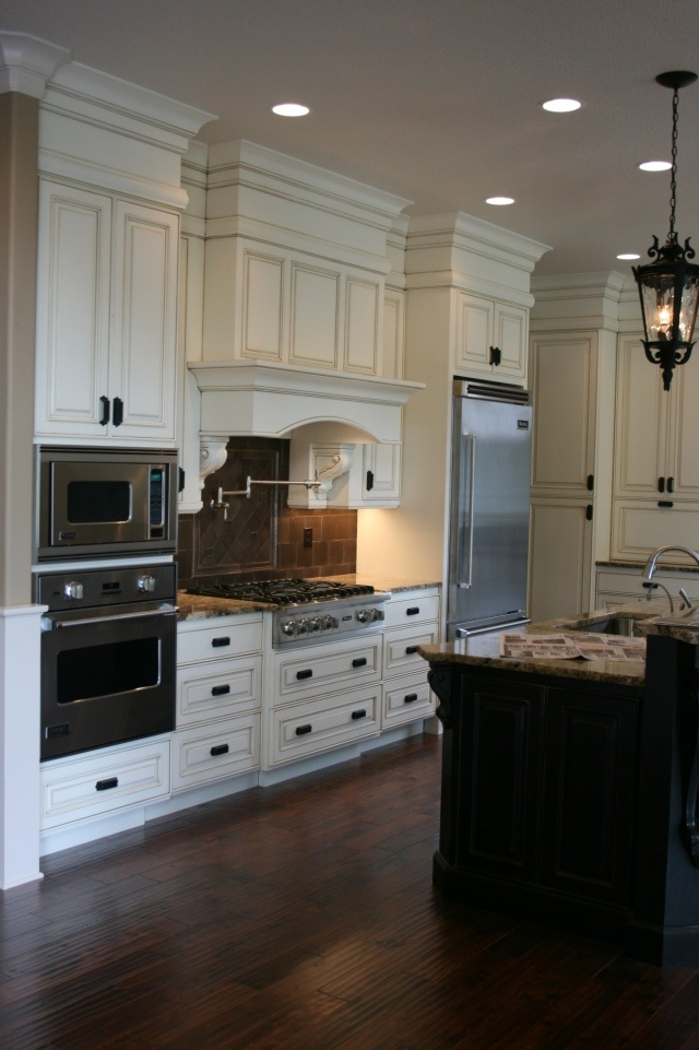 Tall cabinets, frig, stove, microwave and oven on same wall and the Island from what I can see of it is quite big and double lay…   DH Kitchen Cabinets   Pinte…