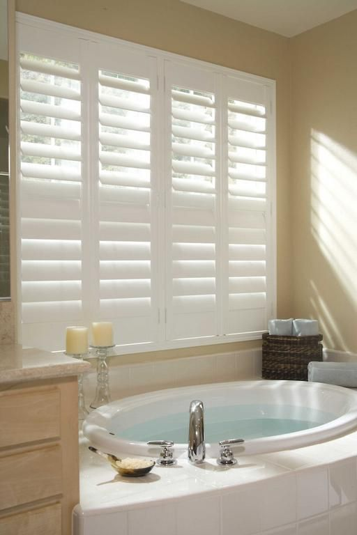 Plantation shutters in the tub area