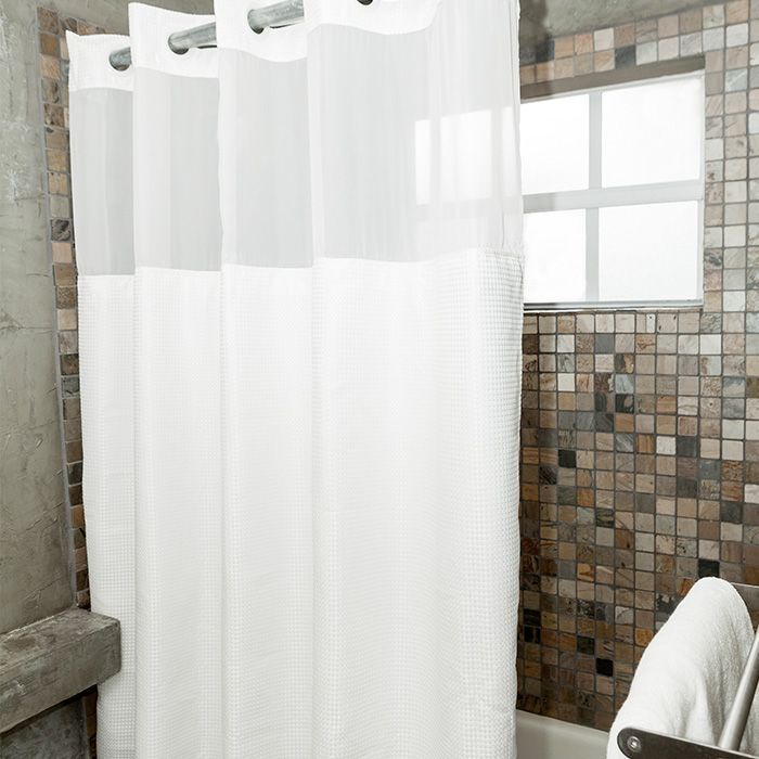 Featuring a Pique woven pattern, this hookless shower curtain is 100% polyester & includes a patented built-in split ring that allows for easy installation & removal without ever removing the rod.  The fabric shower curtain liner is attached with snaps for easy removal & is machine washable to easily remove allergens, mold, or fungus that tends to grow on traditional shower curtains.  Contents: 100% Polyester  Shower Curtain: 71''x74''. $79.98