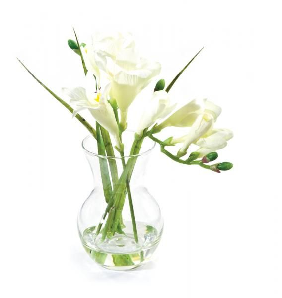 Freesias and leaves in a pristina vase, set in Still Water™. White. Height 20cm. €18.50