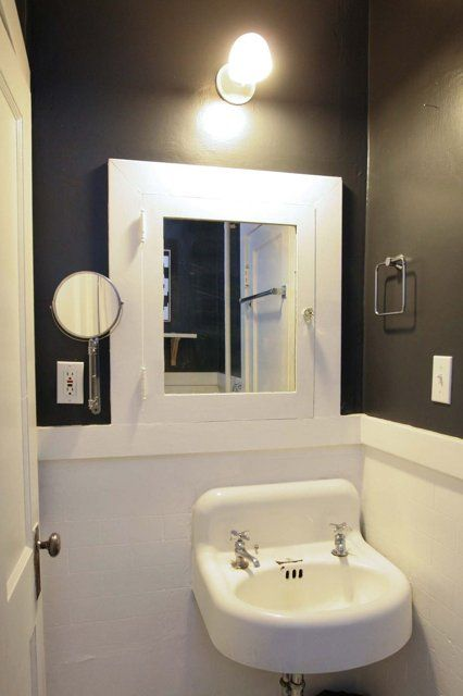 Perfect small bathroom two toned walls in a small for Chair rail ideas for bathroom