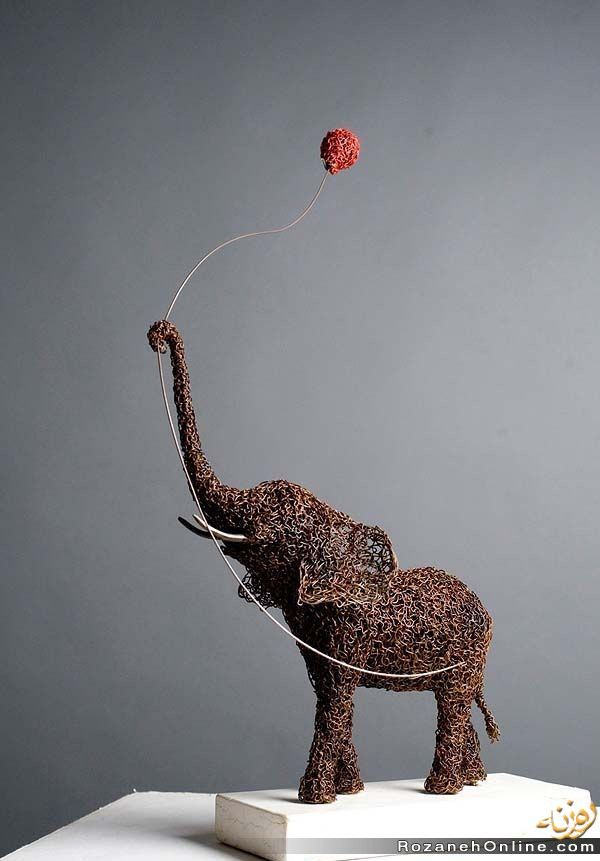 Elephant sculpture. I have no idea who makes this or where you can get it, but I freaking love it.