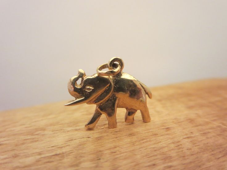 Lovely miniature elephant 10k solid gold necklace pendant or charm bracelet Fashion jewelry  Stamp : 10k  Weight : 2 g.  Good condition- Tested- Guaranteed  TODAY DISCOUNT CODE ! VISIT OUR HOME PAGE ! https://www.etsy.com/ca/shop/LesCurieux?ref=hdr_shop_menu