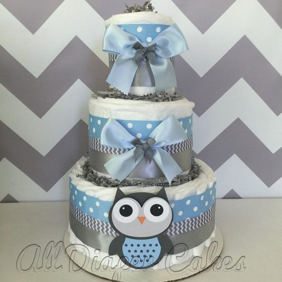 This Deluxe Owl Diaper Cake is constructed of 3 layers of brand name diapers and high quality ribbons and bows. Decorated in a popular light blue and gray color scheme. This 3 Tier Diaper Cake would make the perfect centerpiece at the upcoming themed baby shower