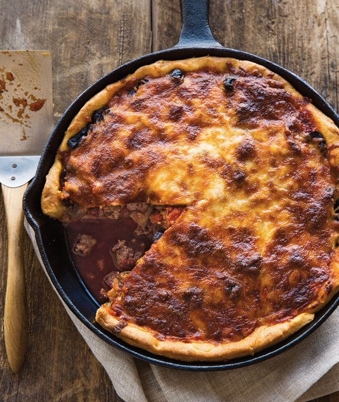 Fully-Loaded Deep-Dish Pizza | One of the best pans for cooking a deep-dish pizza is a cast-iron skillet; the bottom and sides of the pan maintain a high temperature, producing a crispy crust.