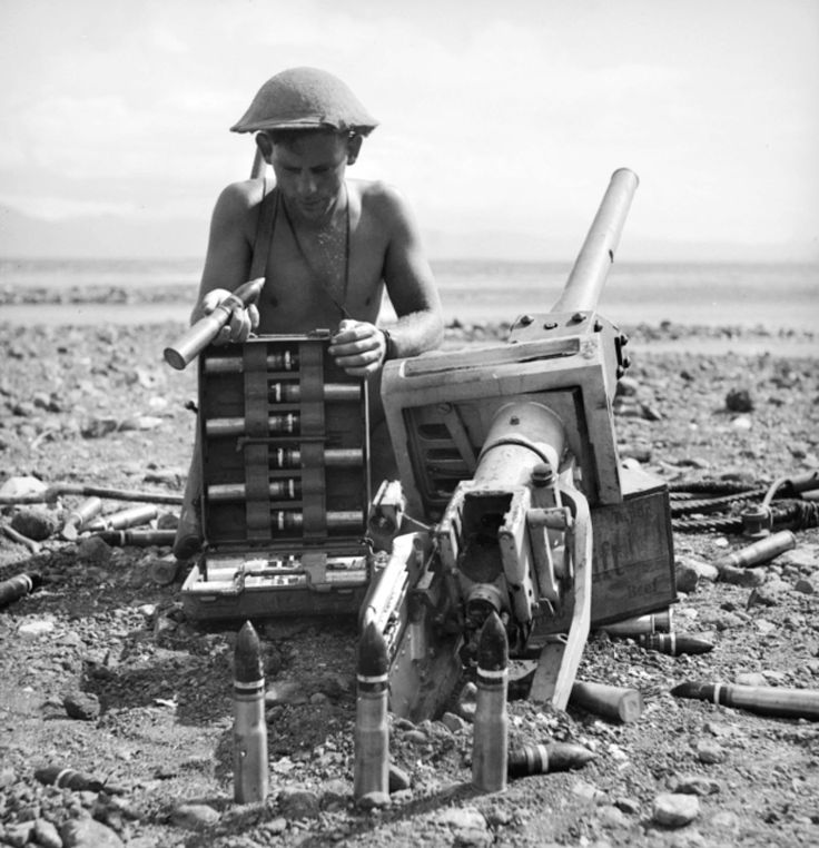 An Australian Army soldier inspects an abandoned Japanese gun and shells following the Allied victory at the Battle of Milne Bay during the New Guinea Campaign. The battle commenced when elite Japanese Special Naval Landing Forces with tank support...pin by Paolo Marzioli