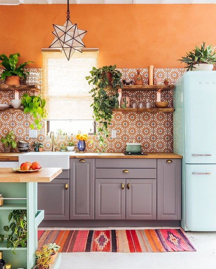 This kitchen was SO fun for me to design. I got to design my dream kitchen for small spaces. The cement tile was the jumping-off place for the color scheme and then we just kept on adding layers of goodness. I love this kitchen for how it looks but also it functions. The dishwasher and stove are super compact but perfect for our needs--and don't get me started on the mint green Smeg! -@justinablakeney