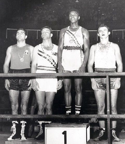 Ali (then Cassius Clay) on the stand t the Olympics recieving his Boxing Gold Medal #olympics #boxing #sport