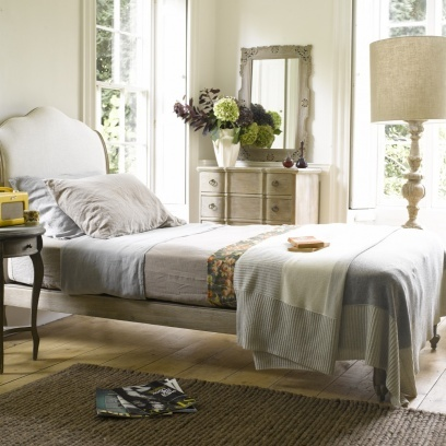 COCO  This beautiful French bed in weathered oak is handmade by the graduates of a traditional carving school. Comes with slightly sprung slats and covered in a natural linen/cotton fabric. Order yours from Loaf here:  http://loaf.com/products/coco-bed