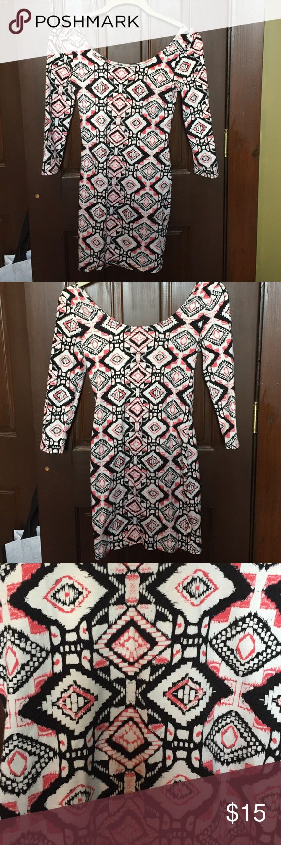 Patterned bodycon dress Super cute patterned dress. Only worn a could of time and is in great condition. The sleeves are 3/4 length. Charlotte Russe Dresses