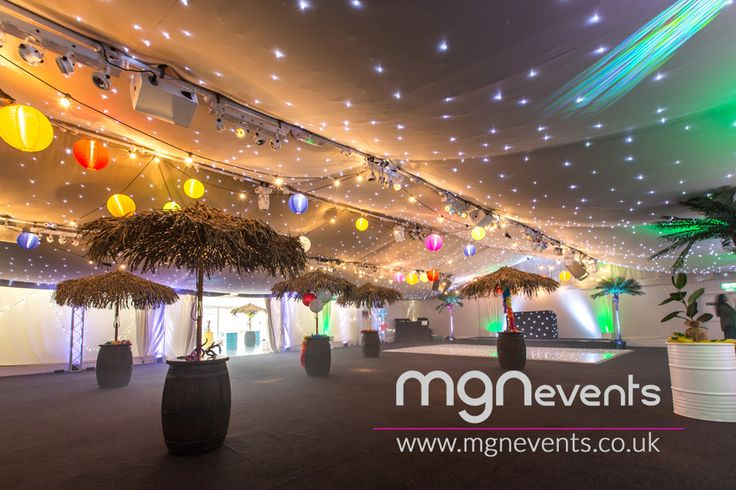 Rio Carnival themed corporate party with, cool decor, LED dancefloor, indoor lighting, beach bar, steelband, stiltwalkers and much more! #carnival #indoorlighting #corporateparty #birdsofparadise #steelband #entertainment #cooldecor #lanterns #fairylights #ledlights #palmtrees