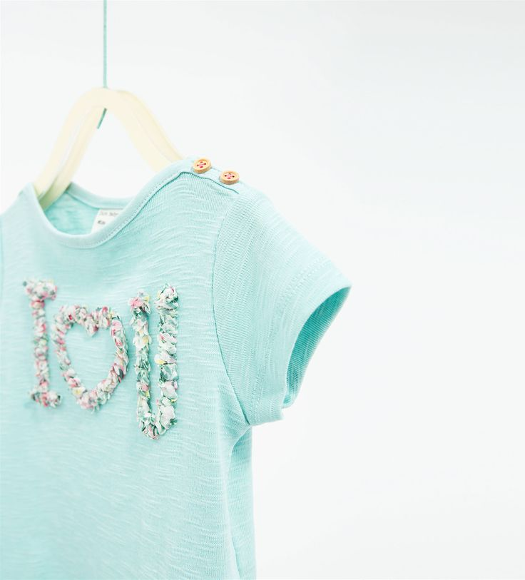 Text and flower top